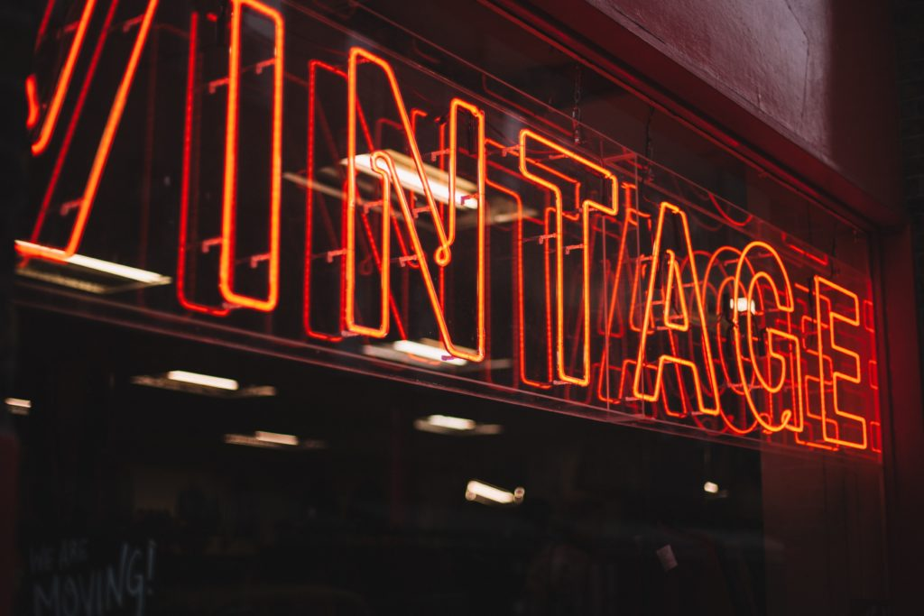 Spooky neon vintage sign outside a thrift store window in West Hollywood