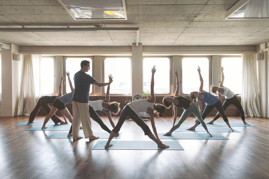 Photo of people doing yoga